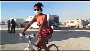 cute girl on bicycle naked on beach